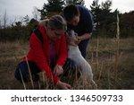 family tour. dog walking | Shutterstock . vector #1346509733