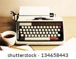 vintage beige typewriter | Shutterstock . vector #134658443