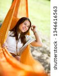 young cute girl enjoy in orange ... | Shutterstock . vector #1346616563
