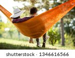 back view of young man and girl ...   Shutterstock . vector #1346616566