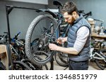 handsome repairman serving a... | Shutterstock . vector #1346851979