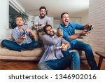 smiling male friends playing...   Shutterstock . vector #1346902016
