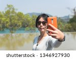 traveling asian woman at the... | Shutterstock . vector #1346927930