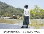 traveling asian woman at the... | Shutterstock . vector #1346927933