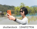 traveling asian woman at the... | Shutterstock . vector #1346927936