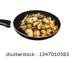 fried potatoes in a pan on a... | Shutterstock . vector #1347010583