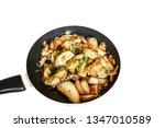 fried potatoes in a pan on a... | Shutterstock . vector #1347010589