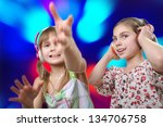 two cheerful  young girls with... | Shutterstock . vector #134706758