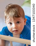 the baby boy lying on his... | Shutterstock . vector #1347103340