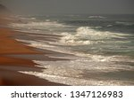 Sloping Beach With White Foamy...