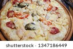 pizza on the table | Shutterstock . vector #1347186449