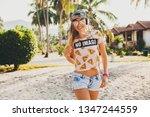 pretty hipster woman walking on ... | Shutterstock . vector #1347244559