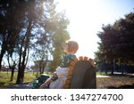 redhead girl in the park spring ... | Shutterstock . vector #1347274700