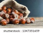hazelnuts  filbert on old... | Shutterstock . vector #1347351659