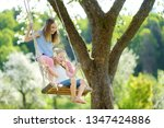 two cute sisters having fun on... | Shutterstock . vector #1347424886