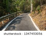 small road by trees with nobody ... | Shutterstock . vector #1347453056