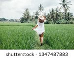 Young Girl Walking In Rice...