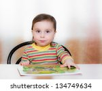 happy kid is sitting at the... | Shutterstock . vector #134749634