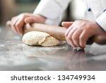 chef preparing dough in a... | Shutterstock . vector #134749934