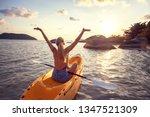 girl  on kayak  sea at sunset ... | Shutterstock . vector #1347521309