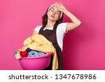 tired busy european woman holds ... | Shutterstock . vector #1347678986
