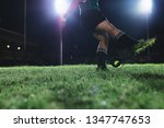 Rugby Player Kicking The Ball...