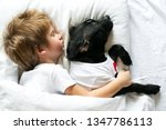 cute baby sleeping with his dog | Shutterstock . vector #1347786113