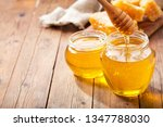 jar of honey with honeycombs on ... | Shutterstock . vector #1347788030
