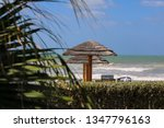 beautiful beach huts on a... | Shutterstock . vector #1347796163