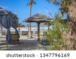 beautiful beach huts on a... | Shutterstock . vector #1347796169
