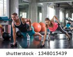 young couple sport exercise... | Shutterstock . vector #1348015439