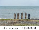 man and concrete pillars... | Shutterstock . vector #1348080353