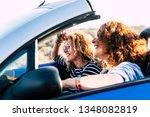 two curly beautiful women... | Shutterstock . vector #1348082819