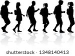 silhouette people on a walk. | Shutterstock .eps vector #1348140413
