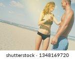 happy woman using sun... | Shutterstock . vector #1348169720