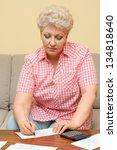 senior calculating her debts...   Shutterstock . vector #134818640