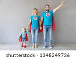 family of superheroes playing... | Shutterstock . vector #1348249736
