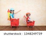 happy child playing with toy... | Shutterstock . vector #1348249739