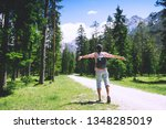 hiker woman with raised arms up ... | Shutterstock . vector #1348285019