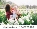 beautiful loving mother and... | Shutterstock . vector #1348285103