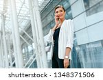 beautiful woman with phone work ... | Shutterstock . vector #1348371506