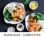 Small photo of Salmon skewers and rice - healthy lunch table. Grilled salmon fish skewer on a dark background, top view