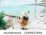 girl relaxing in hammock in... | Shutterstock . vector #1348422446