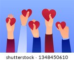 hands holding hearts. charity... | Shutterstock .eps vector #1348450610