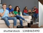 emotional friends playing video ... | Shutterstock . vector #1348465490