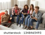 emotional friends playing video ... | Shutterstock . vector #1348465493