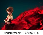 Woman In Red Blowing Flying Re...