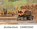 A Log Truck Delivers A Load Of...