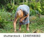 senior woman working in her... | Shutterstock . vector #1348548083