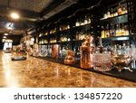 Stock photo classic bar counter with bottles in blurred background 134857220